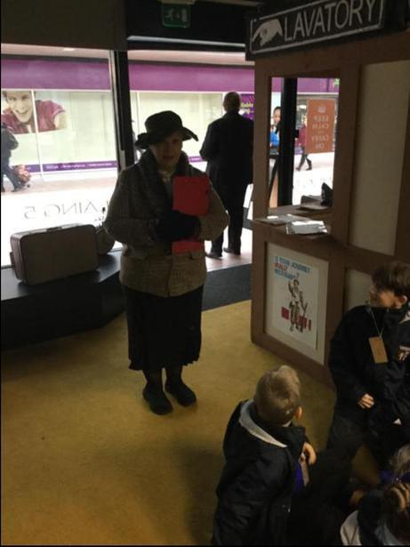 The evacuees meet Mrs. Macready.