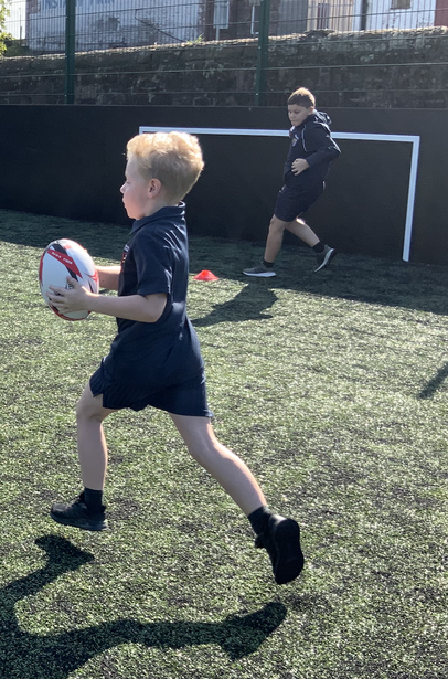 Working independently on running, dodging and passing techniques.