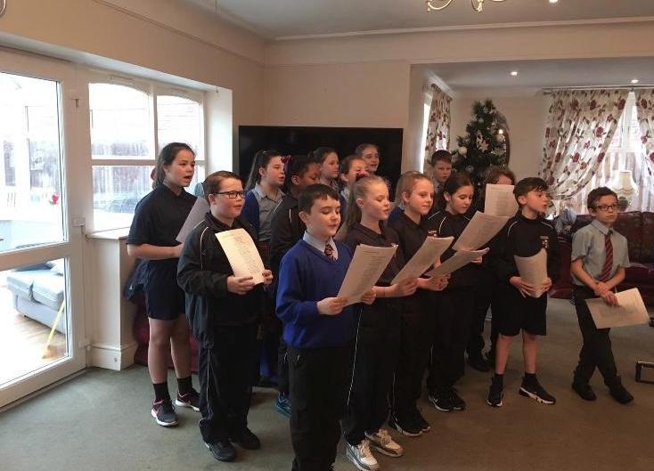 Some Y5 & Y6 children performing at Walton Manor