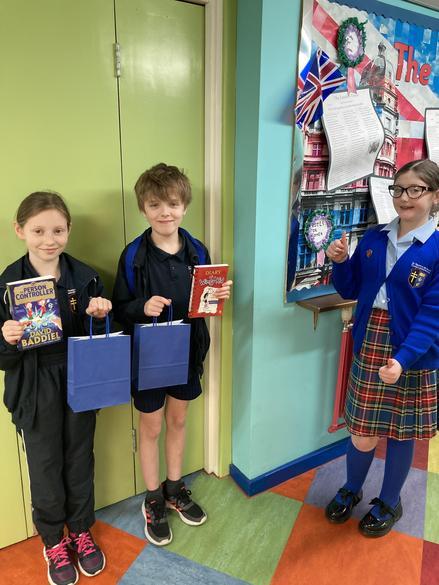 A Reading Ambassador presenting 'World Book Day' prizes