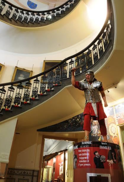 A Roman will greet you as you enter!