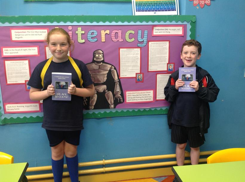Our Writing Ambassadors receiving their copy of our 'We Are Writers' Poetry Book