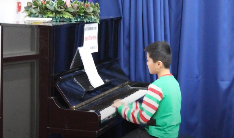 Performing a piano solo in our school concert