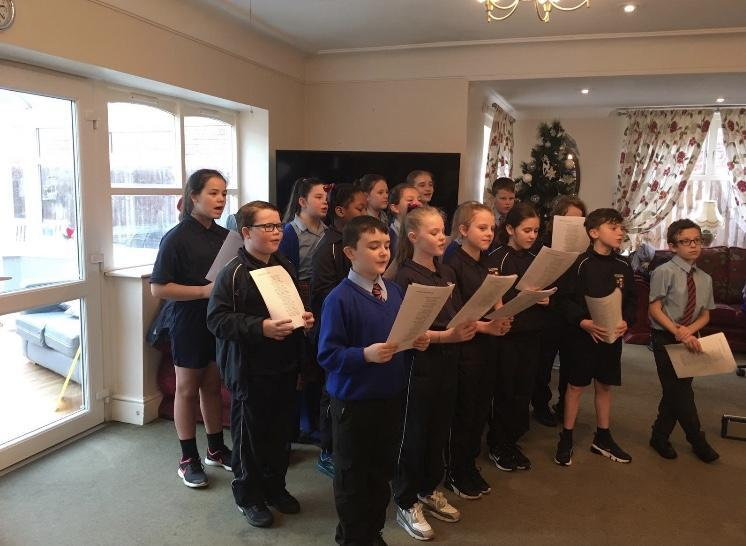 Some Y6 pupils performing at a local care home