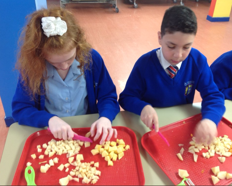 Using the claw grip to chop vegetables into a dice