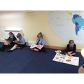 We enjoy reading in our school library.