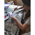 Emily painting VE day bunting