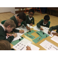 Children creating Islam-inspired calligraphy
