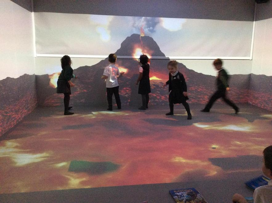 Children explore a volcano in the immersion room