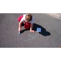 We practiced our names using chalk in the outdoor area.