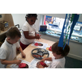 In the playdough area we squash and squeeze the dough to strengthen our finger muscles in