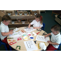 Finger painting our initial sound of our names