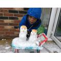 Praise's snowmen for measuring