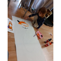 Poppy has been painting a huge Tiger!
