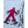 Olivia making a snow angel.