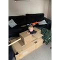 Tommy made a tank from cardboard boxes