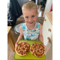 Roman made his own pizzas.