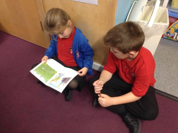 We love reading to our Y5 buddies on Tuesdays!