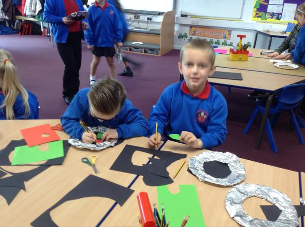 Making a spaceship porthole in our space workshop!