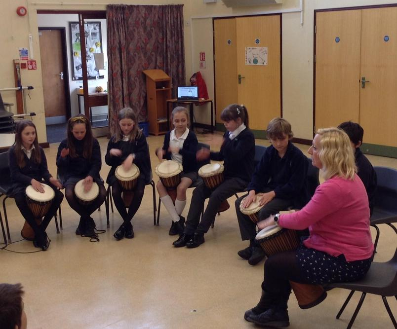 We are learning to play Djembe drums