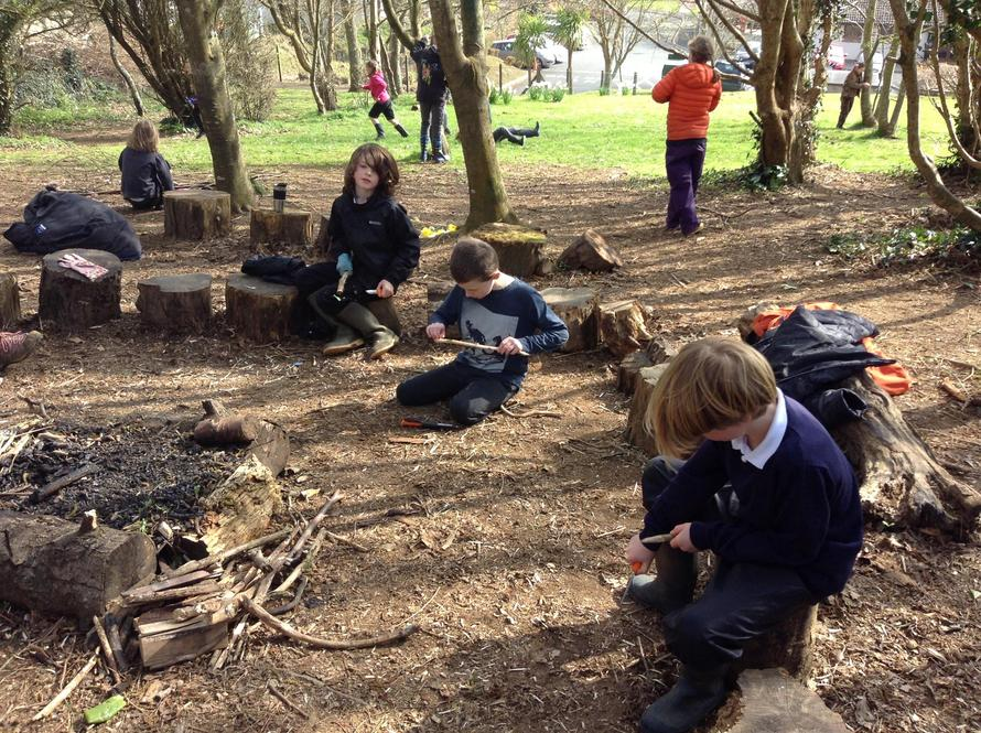 Avocets class were whittling wood to make their own totem pole
