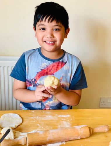 Nathaniel making a pork bun