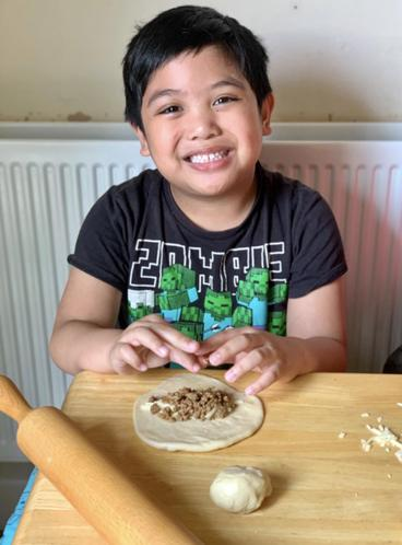 Nathaniel making empanadas