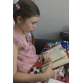 Lucy reading her new book