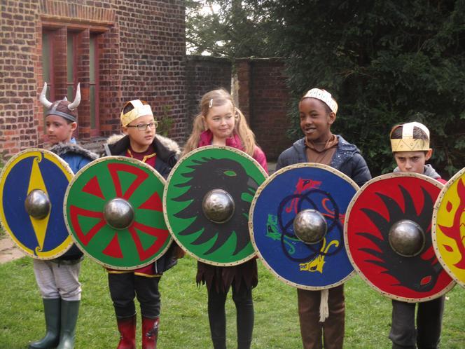Viking warriors creating a shield wall.