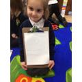 Writing a sentence.
