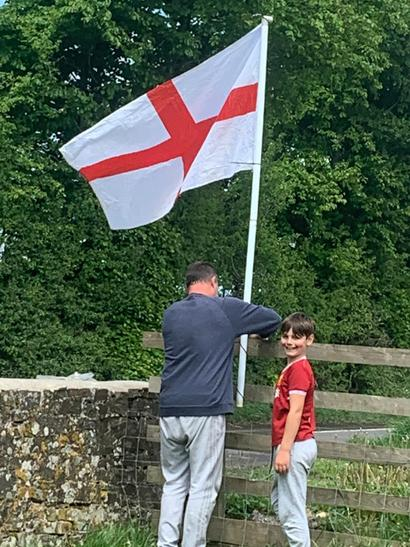 Tommie putting up the English Flag for VE Day