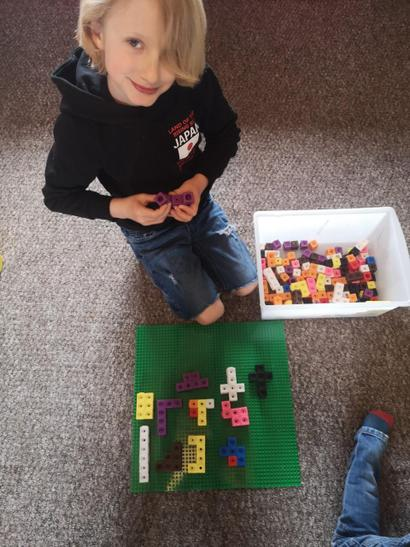 Finn making shapes out of 6 cubes