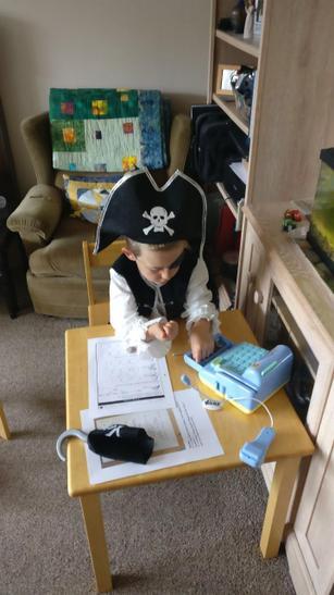 Alex as a pirate running his shop
