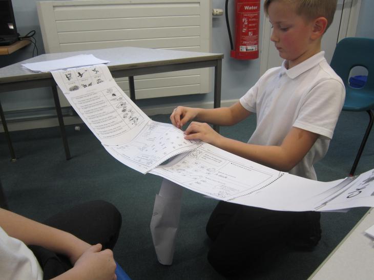 Building paper bridges.