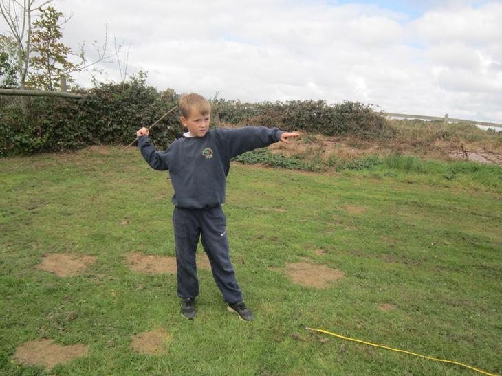 Throwing the javelin.