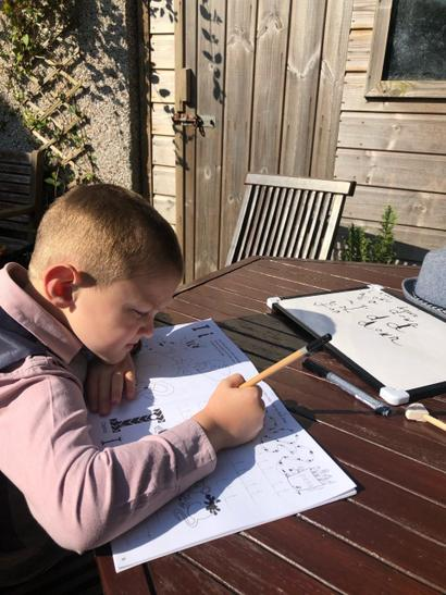 Samuel writing letters in the sun