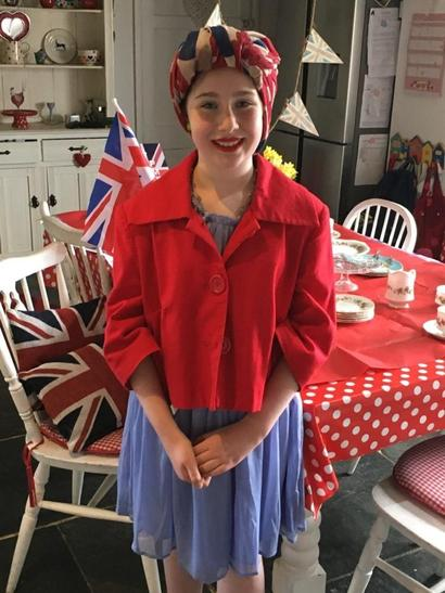 Izzy dressed up in 1940's clothing for VE Day