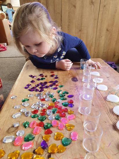 Skye sorting her coloured gems