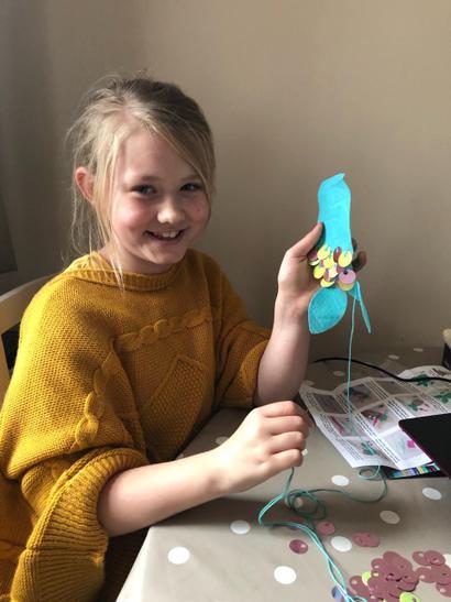 Alexia sewing a mermaid