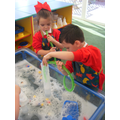 Blowing bubbles in the water tray.