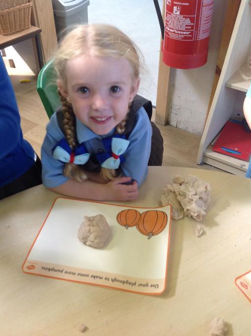 Making pumpkins using the playdough.