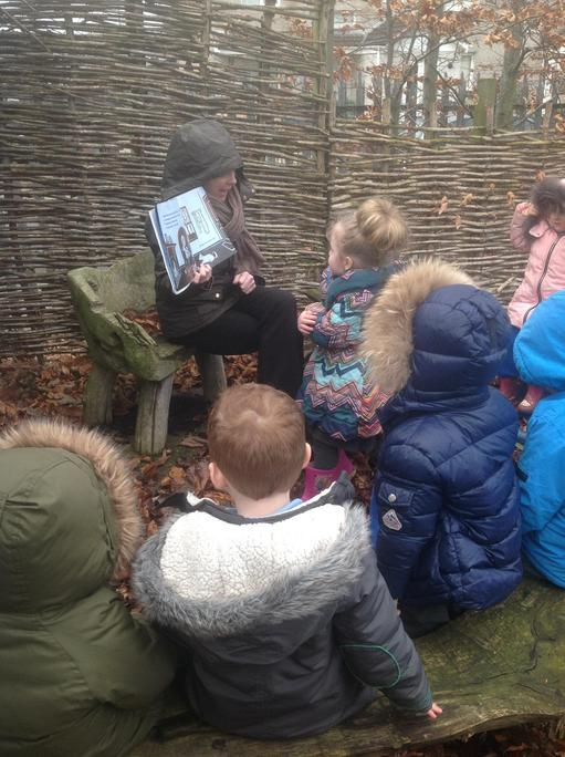 Nursery enjoyed listening to our story outside.