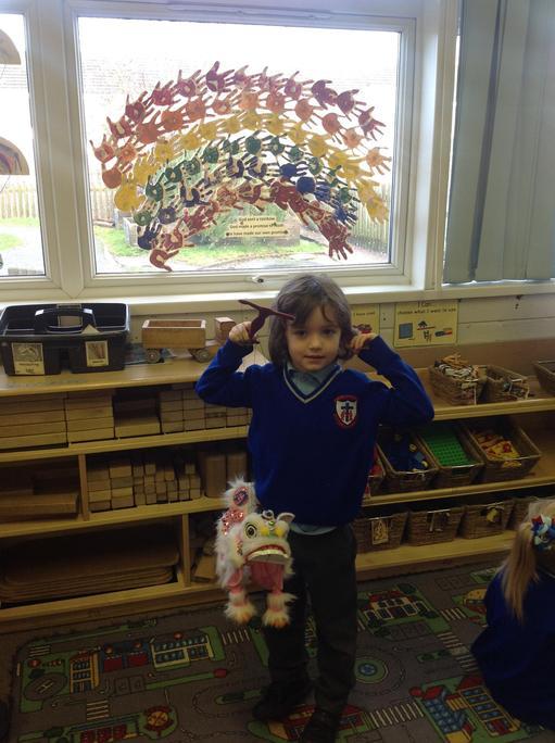 Isaac had a dragon puppet .