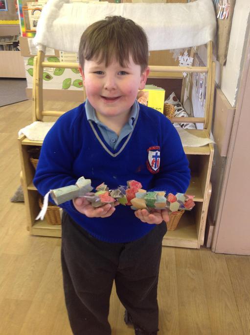 Ayden made a dragon using cardboard tubes!