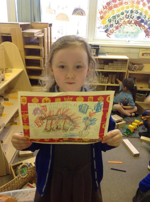 Evie drew a dragon.