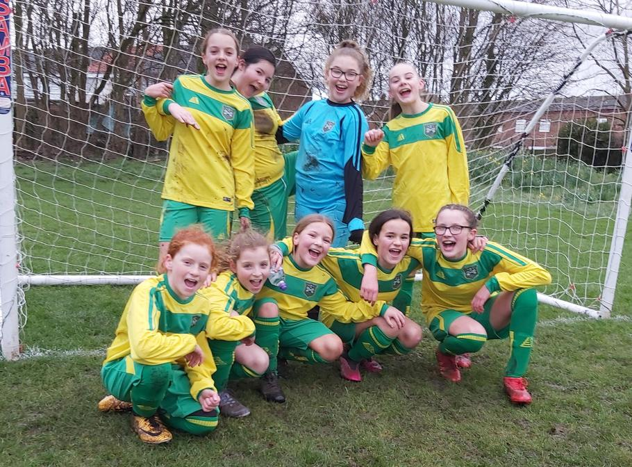 St Gregory's  Girls Football Team displaying their new team strip.