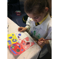 Painting symmetrical drawings using colour theory.
