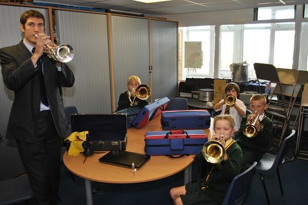 Mr Palmer leading a brass lesson
