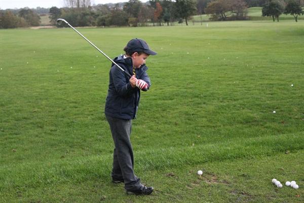 Children having fun during golf club