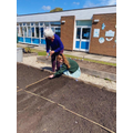 Green-fingered Year 6 children planting flowering plants, vegetables and salads!